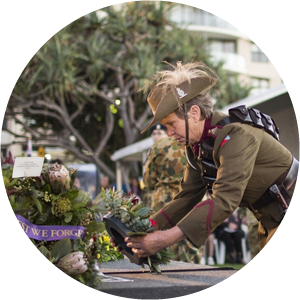 Lyn Gurney laying a wreath on Anzac Day at Kings Beach Caloundra Queensland 2015